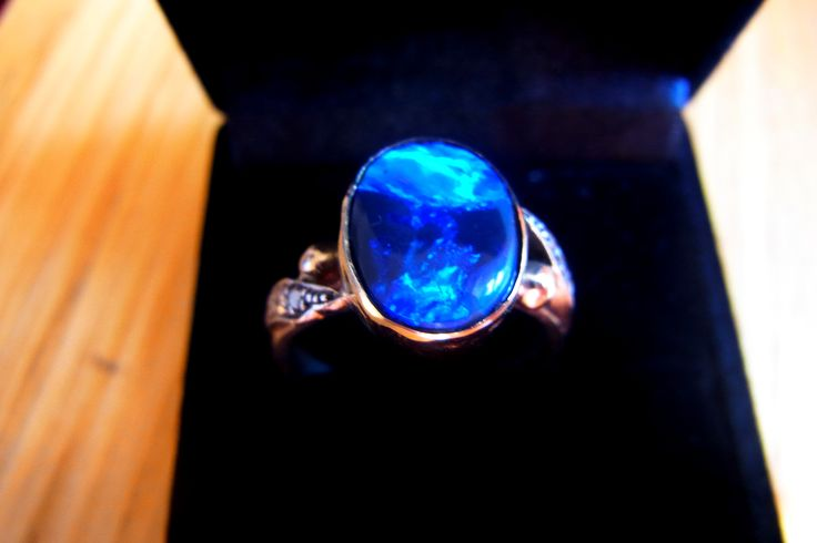 Just Sold this beautiful Lightning Ridge Solid Opal.I set this opal into an existing 9 carat gold ring owned by a lady for many years.The previous opal broke after many, many years of wearing. www.gemniopals.com,au All Opals cut and polished by 'Yours truly'! www.gemniopals.com.au A