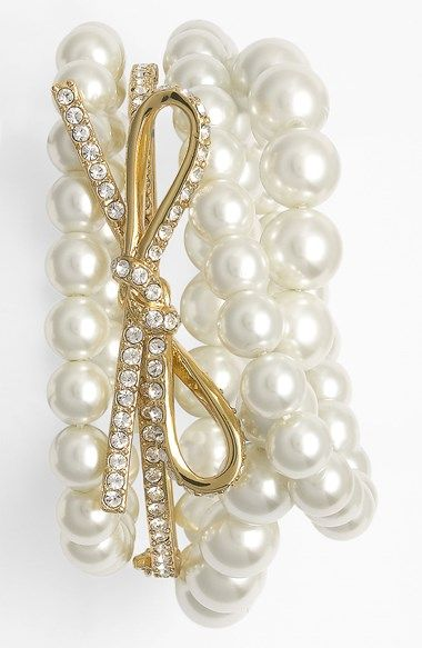The prettiest pearl and bow bangle stack wrist.
