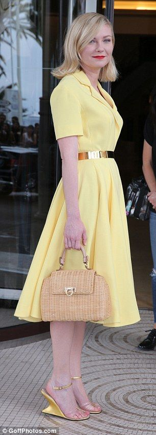 All about the accessories: Kirsten carried a small wicker handbag with her on the outing
