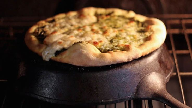 Pizza stones really are the best way to cook a pizza, but they can take up a lot of space and the good ones aren't always affordable. Use your cast iron skillet as a makeshift pizza stone to still get that crispy crust.