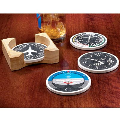 """Instrument Stoneware Coasters Absorbent and Aviation More than a novelty, these Instrument Stoneware Coasters are made from a unique natural composition to continually absorb condensation. A soft, durable cork backing provides further protection. Each set of coasters is complete with Altimeter, Airspeed Indicator, Artificial Horizon, and Directional Gyro along with a solid wooden holder. Coasters are 4"""" in diameter."""