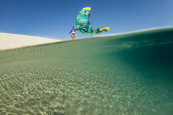 Susi Mai just chilling on a dune in Brazil. Cabrinha kiteboarding and kitesurfing wallpaper.