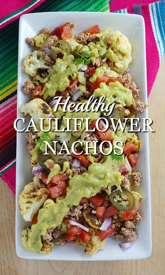 This healthy cauliflower nachos recipe features seasoned and roasted cauliflower that tastes so mind-blowingly good, you won't miss the chips.