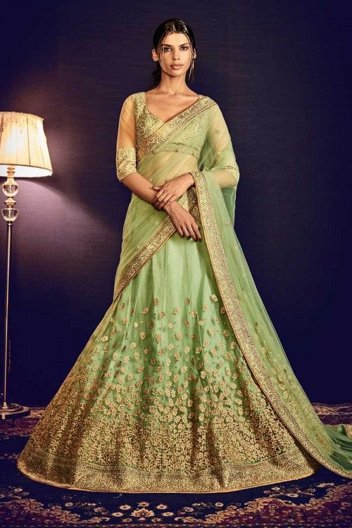 Olive Green Net Lehenga With Raw Silk Choli Olive Green net semi stitch lehenga with raw silk choli. This lehenga choli is embellished with embroidered .Product are available in 34,36,38,40 sizes. It is perfect for Wedding Wear.  Andaaz Fashion is the most popular designer wear online ethnic shop brands in BROMSGROVE WORCESTER, UK.     http://www.andaazfashion.co.uk/womens/lehenga-choli