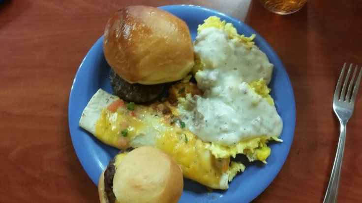 Eggs with meat and white gravy , enchilada , mini hamburger , Sausage patty , bread roll . From Golden Corral