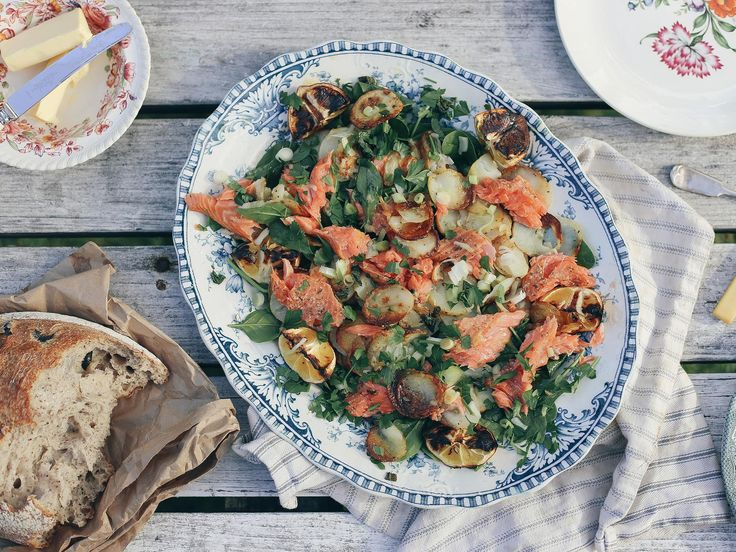 This rustic and nourishing salad is made extra special with luscious salmon, blackened lemon wedges and tender spinach leaves.