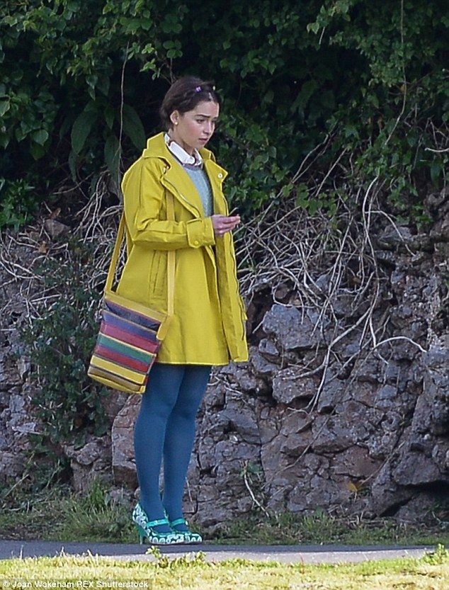 Mismatch: She displayed eclectic taste in a bright yellow jacket and green shoes with blue tights