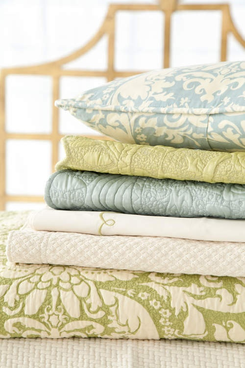 love the soft blue and pear green in these quilts
