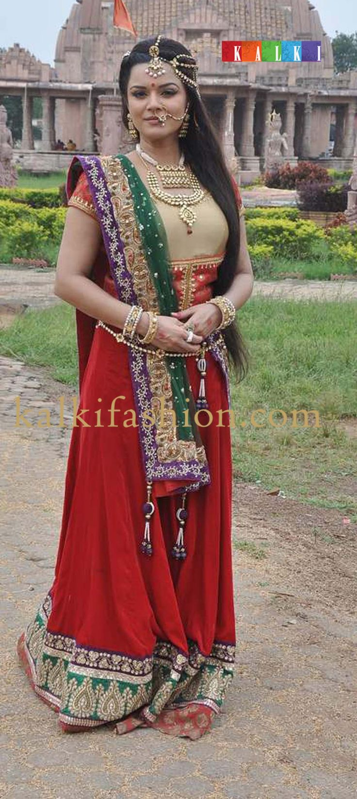 http://www.kalkifashion.com/  Aaskha Goradia in her costume in red lehenga with beige blouse on the set of Maharana Pratap.
