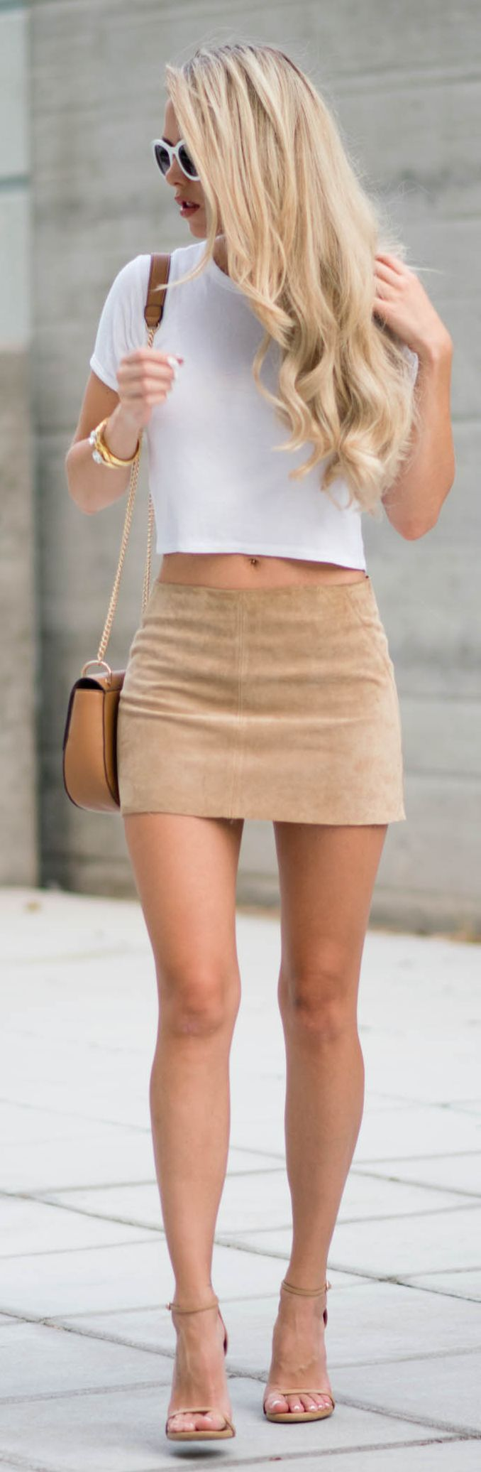 Suede Low Rise Skirt, white top, shoulder bag, sandals. Summer street women fashion outfit