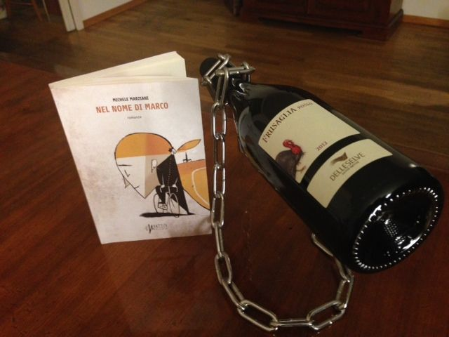"My novel ""Nel nome di Marco"" with a bottle of FRUSAGLiA red, very tasty wine by Società Agricola delle Selve, Emilia Romagna, Italy"
