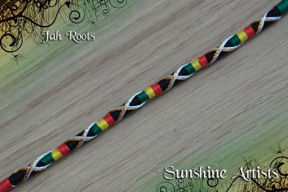 Jah roots rasta hair wrap in bright red, bright yellow, bright green, black with silver gold sparkly, clip in hair accessory, festival hair Jah Roots removable hair wraps with the option of a loop or weft clip to attach. We have 3 shades of weft clip to choose from; blonde, brunette