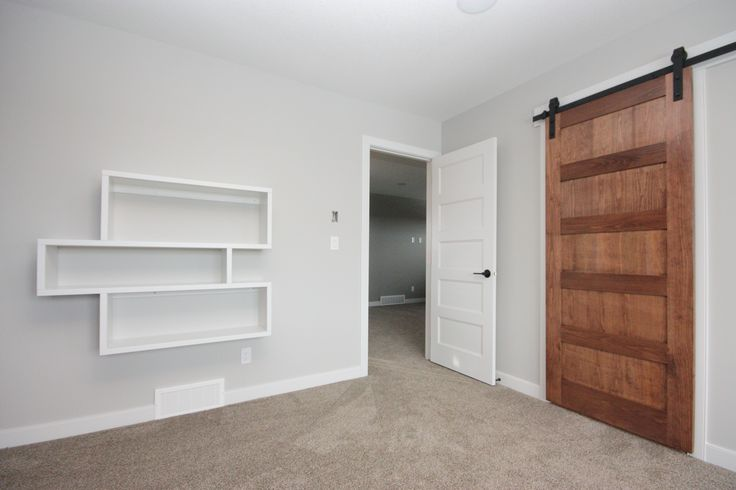 Custom bookshelves, barn door, master bedroom