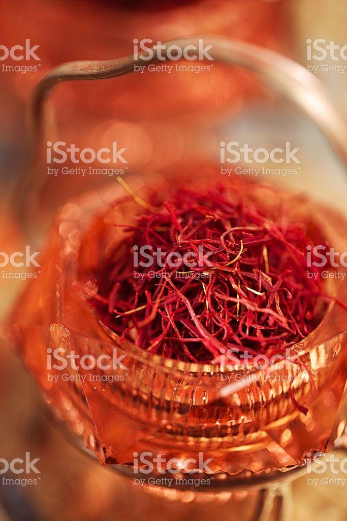 saffron spice in antique vintage glass bowl, closeup royalty-free stock photo