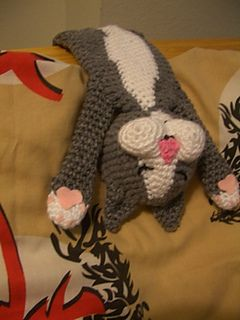 This is an amigurumi pattern of a cat I saw in Pinterest. It was asleep hanging over it's owner's arm. In order to match it's coloring I used white and gray yarn. I also glued on pink felt for the paws and embroidered the eyes and mouth.
