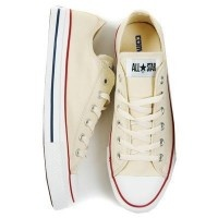 Cream low top Converse + white replacement laces. $38.00