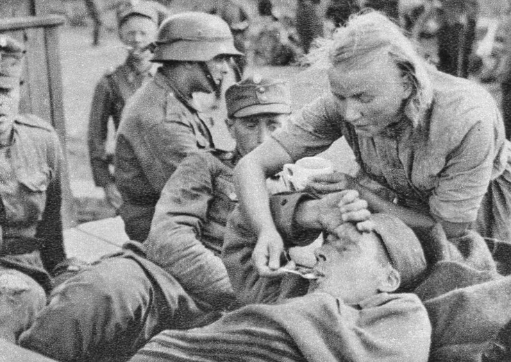 fallschirmjager:    A Lotta Svärd feeding a wounded soldier during the Continuation War.