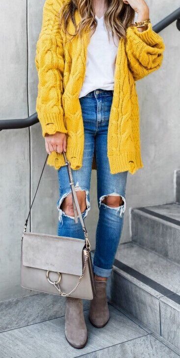 #fall #outfits women's white v-neck top, distressed blue denim fitted jeans, yellow cardigan and gray handbag outfit