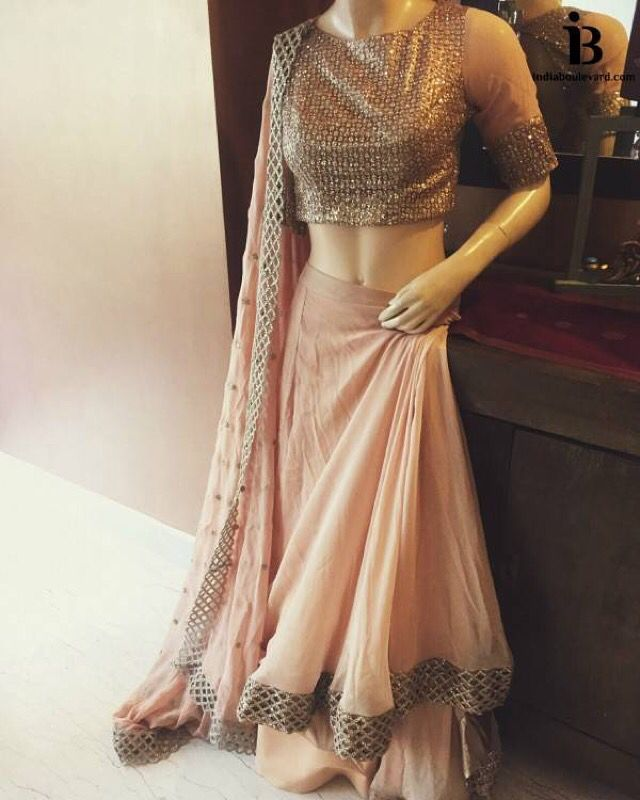 Our monochrome peach lehenga with a matt finished gold/silver blouse. Chic and Cute at its finest. For all prices and inquries, please email us at inquiries@indiaboulevard.com or visit us at indiaboulevard.com #indiancouture #desicouture #indianwear #desifashion #indianfashion #fashionista #customindianwear #allthingsindian #newdesigners #lehenga #bridal #indianembroidery #couture #ootd #aw15 #igers #instagood #asianbride #bollywood #autumn #anarkli #skirt #love #stunning #amazing