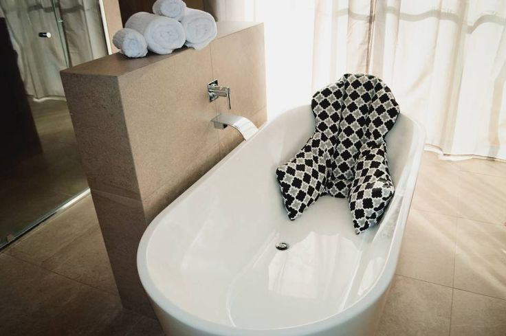 Luxury bath pillow designed to support your body and your neck whist lying in the bath