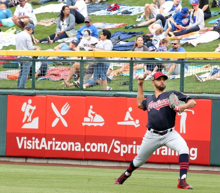 Cleveland Indians starting pitcher Danny Salazar warms up in the outfield in front of the lawn seats before the game against the Chicago Cubs at Sloan Park in Mesa, Arizona on Feb. 26, 2017.  (Chuck Crow/The Plain Dealer)