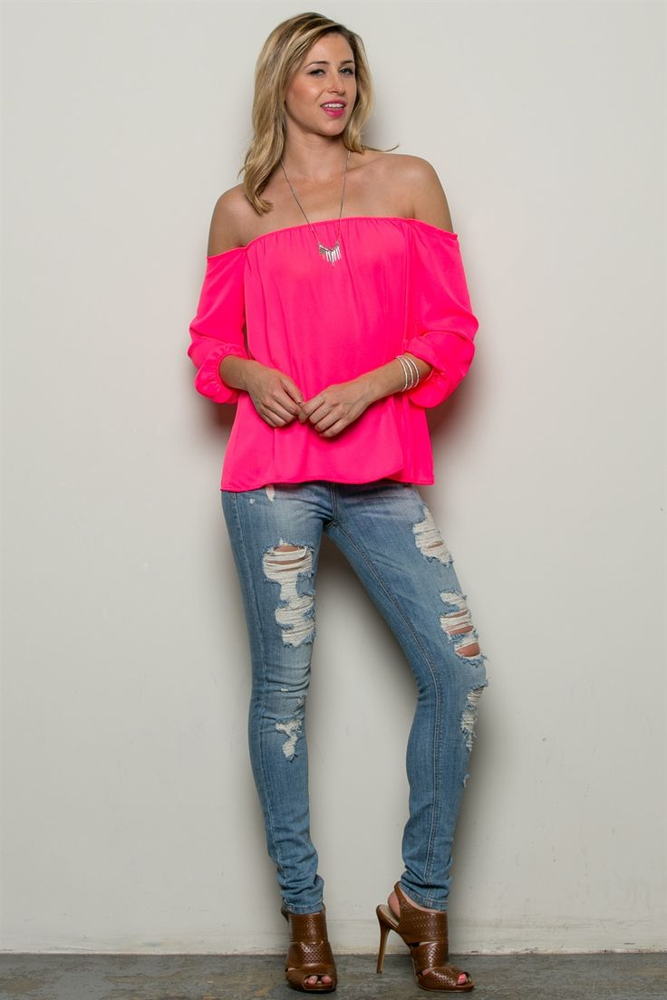 This brightly colored off-the-shoulder beauty is sure to turn heads. It's flowy, colorful, and a bit of sexiness makes this top a must have. This top is also available in mint and yellow.