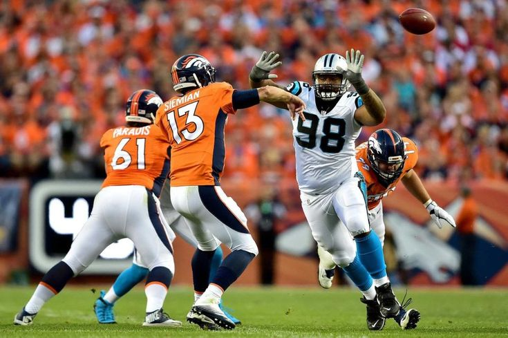 Quarterback Trevor Siemian #13 of the Denver Broncos throws the ball against defensive tackle Star Lotulelei #98 of the Carolina Panthers in the first half at Sports Authority Field at Mile High on Sept. 8, 2016 in Denver.