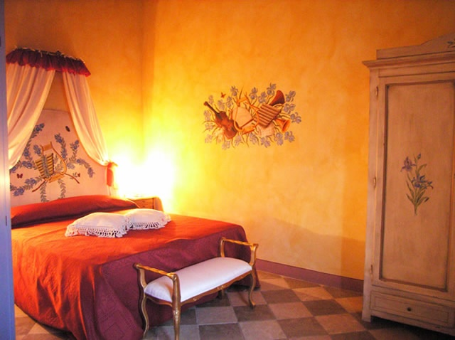 "The romantic room ""Iris"" of romantic hotel in Tuscany Taverna di Bibbiano.  Romantic getaway in Tuscany. Romantic bed and breakfast, romantic farmhouse, romantic restaurant. Rooms with a view.."