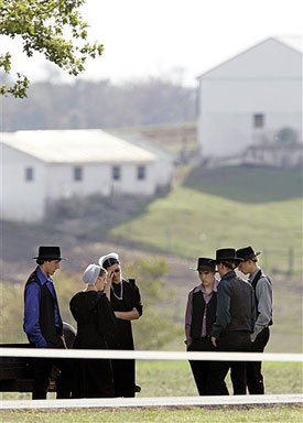 A group of young people gather in Nickel Mines, Pa., Tuesday, Oct. 3, 2006, near the home where a viewing was to take place for one of the victims of Monday's Amish schoolhouse shootings. A man carrying three guns stormed the one-room schoolhouse, sent the boys and adults outside, barricaded the doors with two-by-fours, and then opened fire on several girls, killing five, before committing suicide.