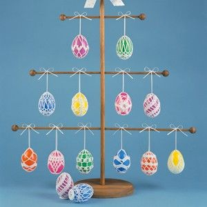 """Crocheted Eggs Thread Crochet ePattern - Hang them on a mini tree or stand them on your Easter table, you'll find these twelve egg covers make your plastic Easter eggs pretty enough to display all year round. Our designs are crocheted using bedspread weight cotton thread (size 10) and a size 8 (1.50 mm) steel crochet hook. Number of Designs: 12 decorative covers Approximate Design Size: Each fits a 2-3/4"""" tall plastic egg"""