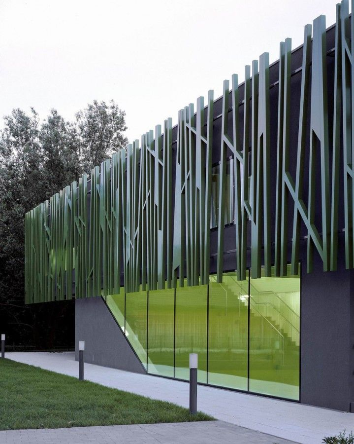 The modern facade of the building combines glass and other solid materials.