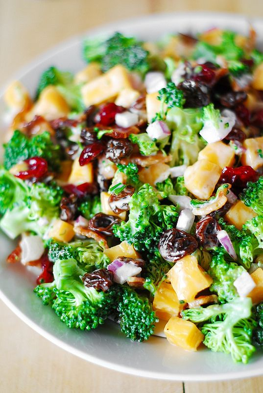 Recipe For Broccoli Salad with Bacon Raisins and Cheese - This salad has a perfect combination of everything: sweet and savory flavors, crunchy veggies and soft cheese, saltiness and smokiness from bacon, freshness and fiber from the vegetables!