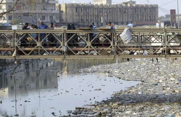 """CANALS OF BASRA, IRAQ  Revered by Iraqis as """"The Venice of Middle East,"""" the city of Basra has canals crisscrossing the city, which are stagnant and full of garbage and industrial disposal."""