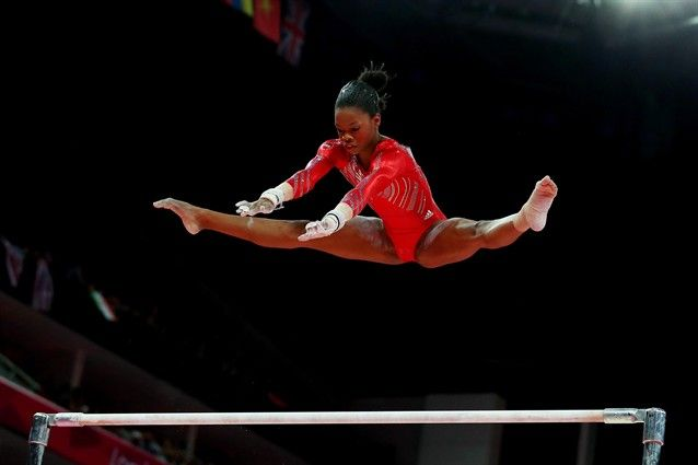 "Gabrielle ""Gaby"" Douglas on the high bars.    The U.S. women's golden night - Gymnastics Slideshows 