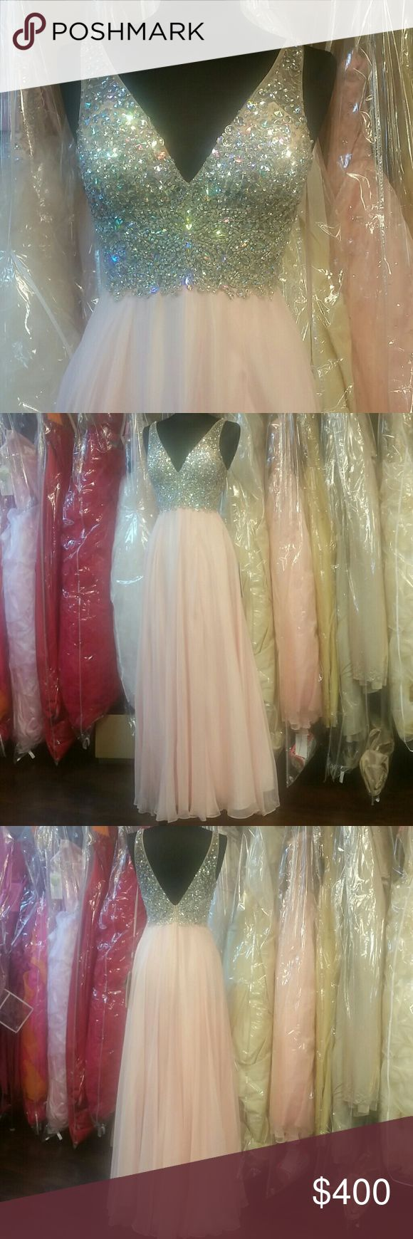 Bejeweled Blush Gown NWT, light pink/blush (color a but darker in real life), sheer bodice with straps and cups, heavily beaded with AB and silver crystals, vneck frong and back, long flowy chiffon skirt w/leg slit, zipper back. Great for prom, homecoming, wedding, pageants, parties, or any formal event. Designer: Let's Fashion, size: Medium, color: blush pink. Sherri Hill for exposure. Sherri Hill Dresses Prom