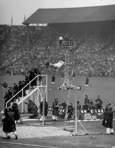 Not originally published in LIFE. American pole vaulter Guinn Smith attempts (unsuccessfully) to break world record, London, 1948.