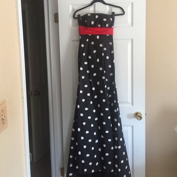 Black and white polka dot formal dress! Long black formal dress with white polka dots and a long silky red ribbon! Perfect for a winter formal or a fancy event! Jovani Dresses