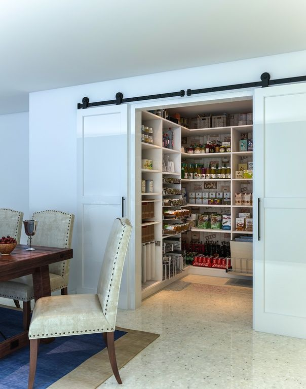 rustic pantry with limestone tile floors built in bookshelf high ceiling rustica hardware two panel barn door
