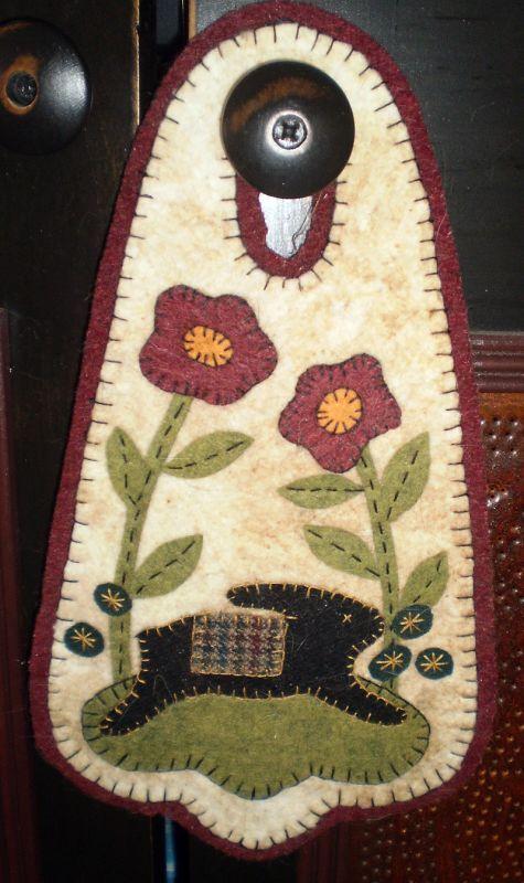 bunny and flowers door knob penny rug