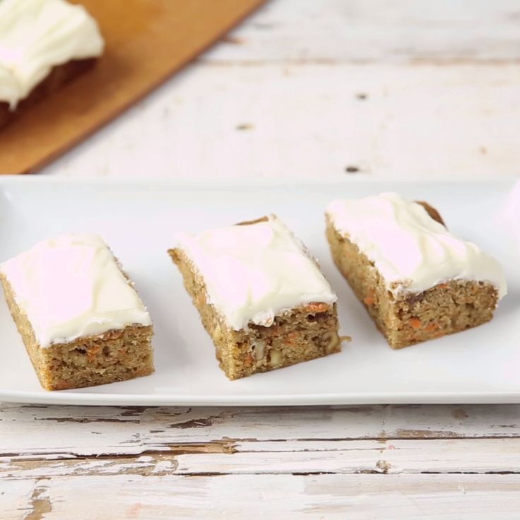 An elegant Carrot Cake but no forks needed. Make these easy Carrot Cake Bars with Cream Cheese Frosting!