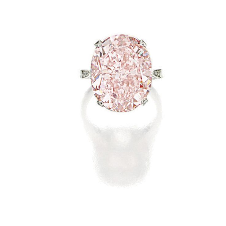 MAGNIFICENT AND RARE FANCY INTENSE ORANGY PINK DIAMOND RING Simply set with an oval fancy intense orangy pink diamond weighing 19.73 carats, to a diamond-set basket and shank, mounted in platinum.