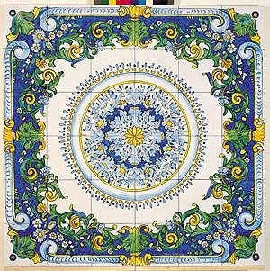 Beautiful Italian tiles. Blue, yellow and white florally patterns and border.