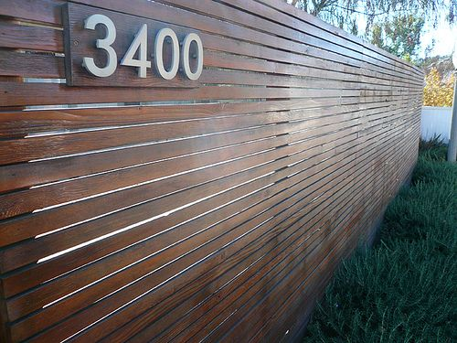 This wood-slat fence is the closet picture I could find of what I want to do for the mailbox.