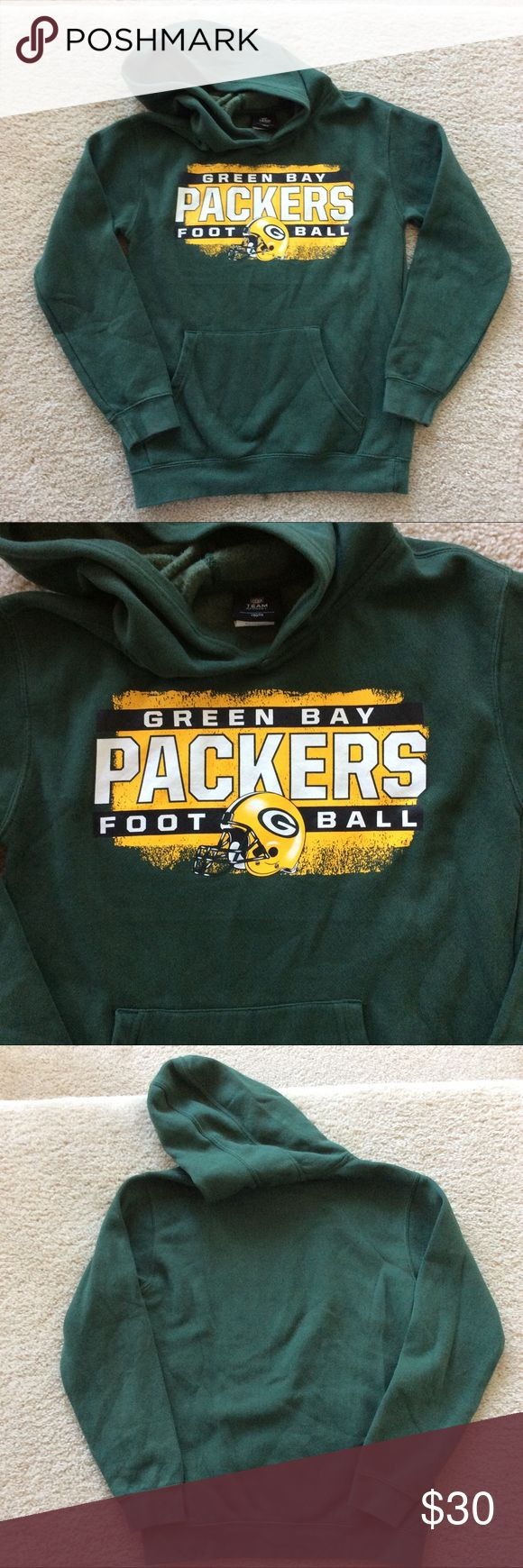 """NFL Team Apparel Green Bay Packers Hoodie NFL Team Apparel Green Bay Packers Hoodie. Front pouch pockets. Long sleeves. Laying flat approx 23.5"""" shoulder to hem, approx 17.5"""" pit to pit. 70 cotton 30 polyester. Size M (10-12). Excellent condition. #d15 NFL Team Apparel Shirts & Tops Sweatshirts & Hoodies"""