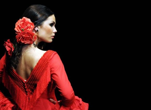 A model presents a creation by Spanish designer Pilar Vera during the SIMOF 2011 (International Flamenco Fashion Exhibition) in Sevilla. Photo: Getty Images / SL