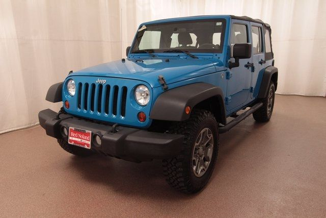 Pre-Owned 2011 Jeep Wrangler Unlimited Sport for more information 719.493.5825