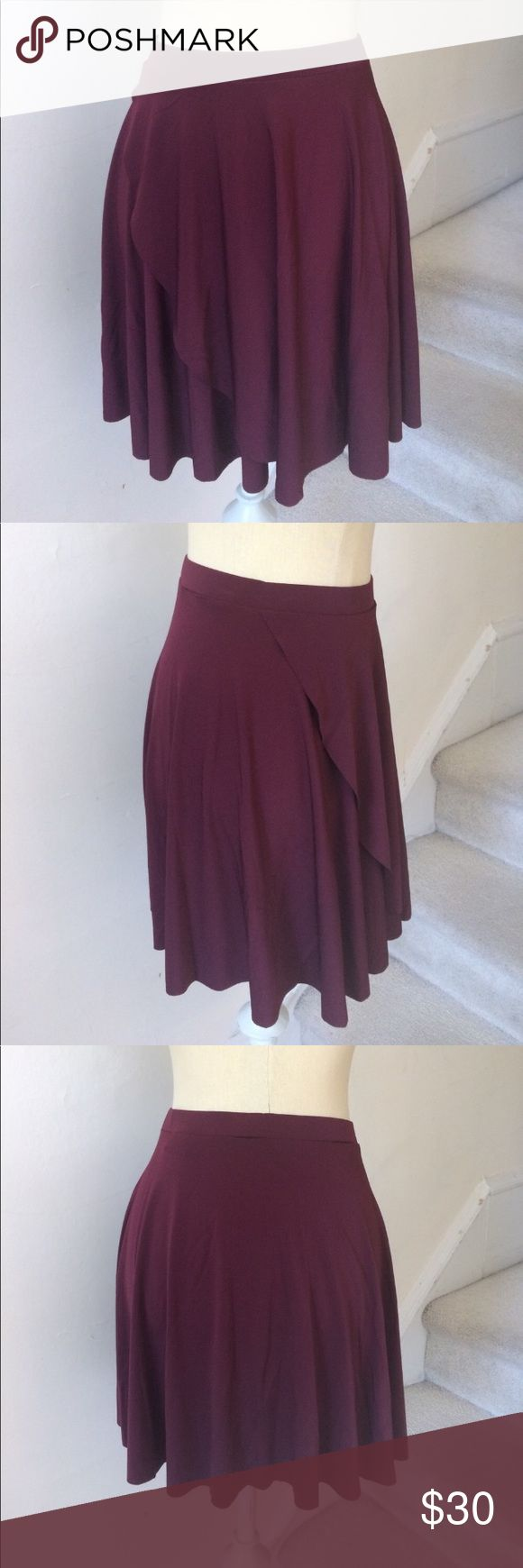 """Urban Outfitters Ballet Faux Wrap Mini Skirt NWOT Adorable faux wrap style skirt from Kimchi Blue (Urban Outfitters)   Plum/maroon color, perfect for both summer and winter!   Size medium   Good length skirt, meaning it's not too short and could be worn for a more formal occasion. Approximate measurements: waist 12 1/4"""" (waistband is very stretchy) length 17"""" new without tags. A13 Urban Outfitters Skirts Mini"""