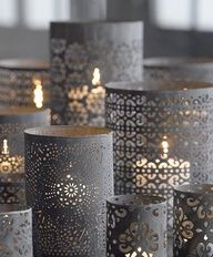 Pre-punched paper at Michaels - wrap it around a glass cylinder and tape with double-sided tape for a lovely effect for your votive candle.