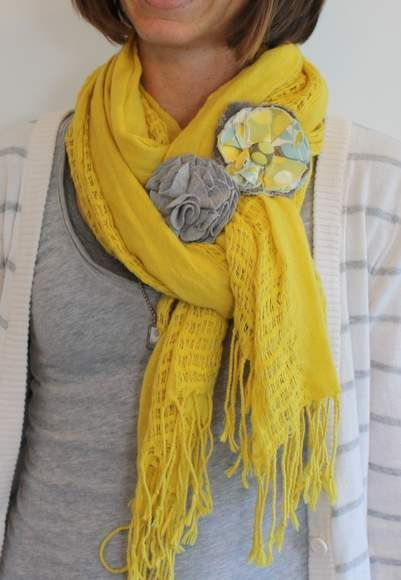 How to tie a scarf. Love the added flower brooches!