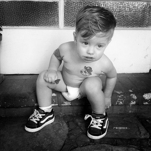 Adorable little rock 39 n 39 roll boy with sneakers and tattoos for Little kid tattoos